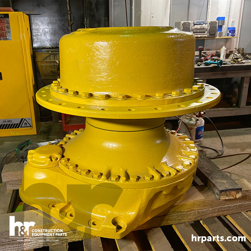A komatsu final drive is painted and palletted.