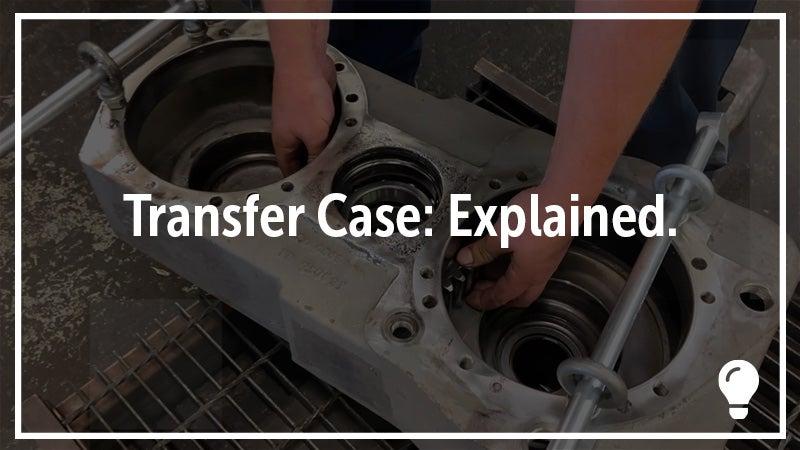 A mechanic works on a transfer case.