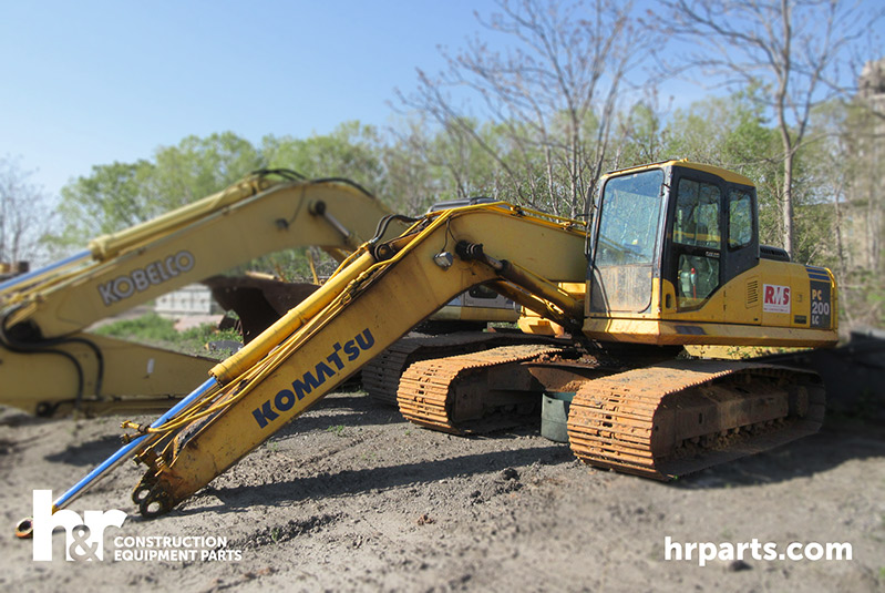 Komatsu PC200LC-7L Excavator in salvage yard.